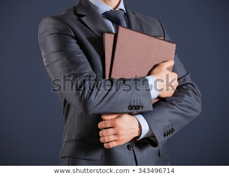 mature businessman holding a folder stock photo © photography33