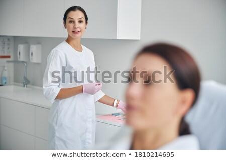 Dark-haired woman posing in a lab Stock photo © wavebreak_media