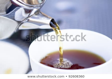 Сток-фото: Pouring Hot Tea From Restaurant Style Cattle