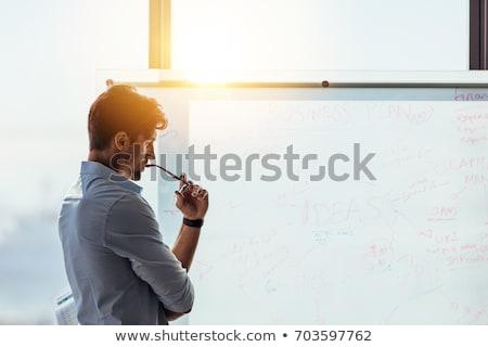 мышления бизнесмен молодые глядя серьезно экране Сток-фото © joseph73