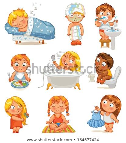 beautiful happy smiling little girl brushing her teeth after bath shower stock photo © len44ik