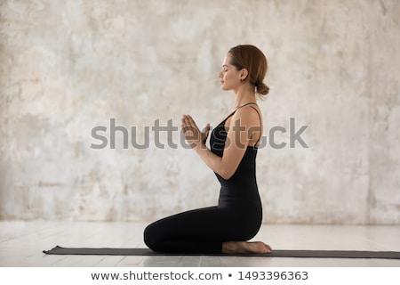 Yandan görünüş genç kadın oturma yoga mat beyaz Stok fotoğraf © wavebreak_media