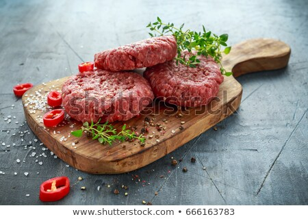 raw patty on wooden board Stock photo © Mikko