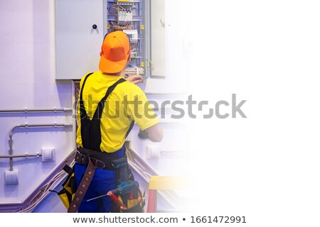 Stock photo: Electrician carrying a voltmeter