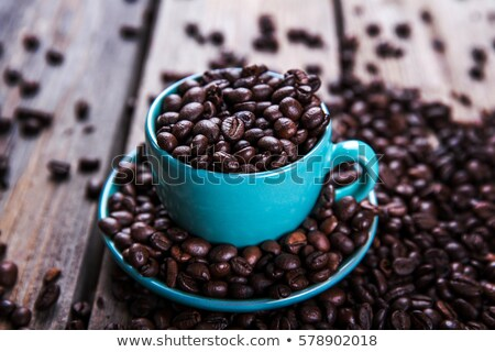 Coffee with beans on serviette Stock photo © w20er