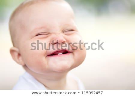 Güzel gülme bebek erkek oturma beyaz Stok fotoğraf © nikkos