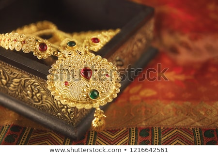 green background with gold ornament and precious stones stock photo © yurkina