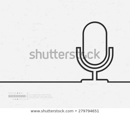 Microphone Icon on Retro Triangle Background. Stock photo © tashatuvango