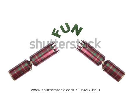 Isolated Christmas Cracker in tartan pattern with fun text Stock photo © jenbray