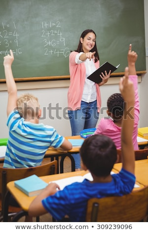female pupil answering question in classroom stock photo © monkey_business