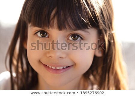 sly child smiling to the camera Stock photo © Dave_pot