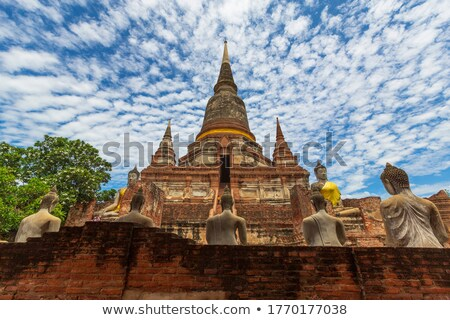 Ancient Buddha statue at Wat Yai Chaimongkol Stock photo © tang90246