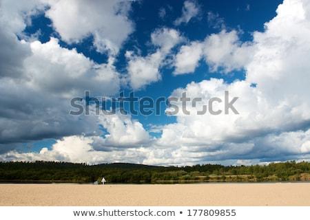 Büyük bulutlar mavi gökyüzü üzerinde nehir gökyüzü Stok fotoğraf © miracky