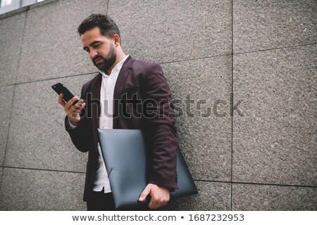 üzletember küldés szöveg tart oldal fehér Stock fotó © wavebreak_media