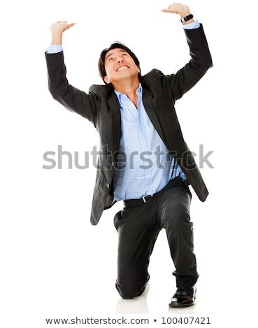 business man lifting something stock photo © fuzzbones0