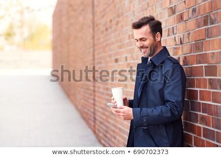 Işadamı tuğla duvar genç gözlük Stok fotoğraf © wavebreak_media