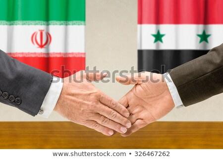 Irã Síria apertar a mão negócio mãos sucesso Foto stock © Zerbor