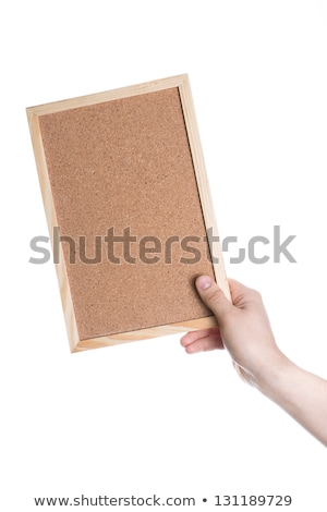 cork-board in woman hands isolated on white Stock photo © tetkoren