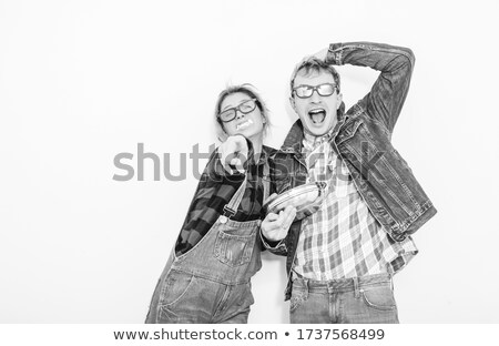 guy wearing glasses and jeans posing seated stock photo © feedough