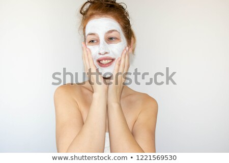 funny young woman with makeup brushes near her face stock photo © vlad_star