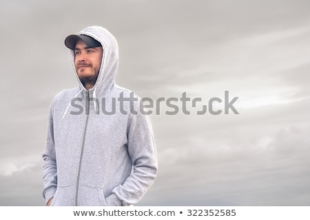 Fiatalember visel kapucnis pulóver férfi divat Stock fotó © zurijeta
