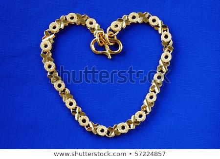 gold ankle bracelet stock photo © bigalbaloo