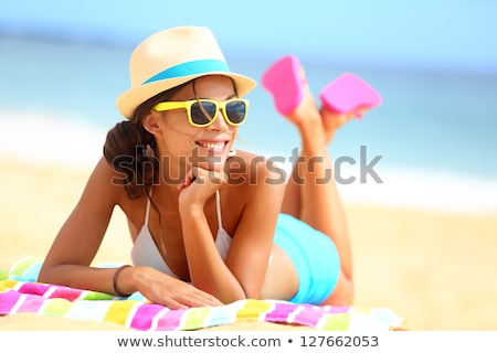 beach vacation woman in bikini wearing sunglasses stock photo © maridav
