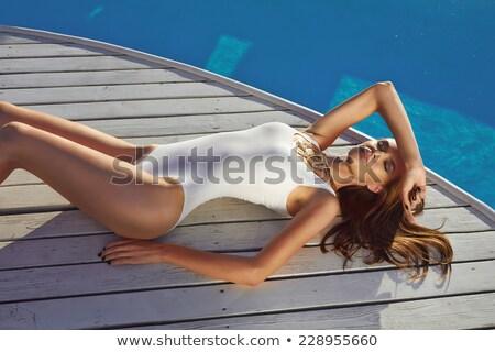 nina · oro · bikini · posando · hermosa - foto stock © pawelsierakowski