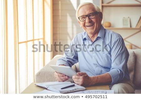 man smiling to camera using a notebook Stock photo © Giulio_Fornasar