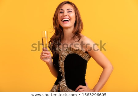elegant woman with red hair holding wine glass stock photo © artjazz