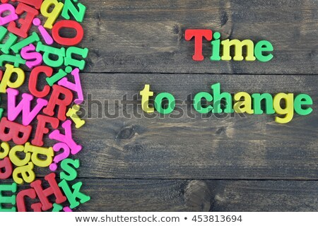 Tine to change on wooden table Stock photo © fuzzbones0