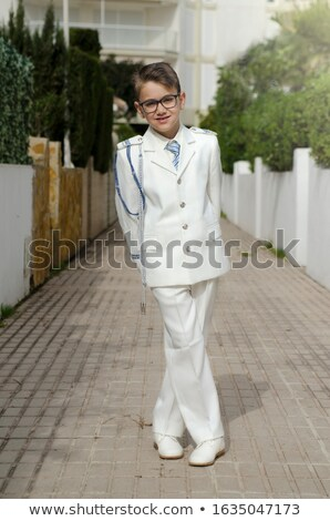 Young boy standing and smiling in his First Holy Communion Stock photo © BigKnell
