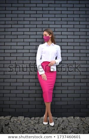Stock photo: Blond hair model wearing gray skirt isolated on white