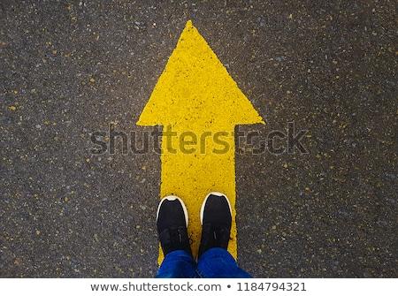 White arrow on asphalt road, traffic sign Stock photo © stevanovicigor