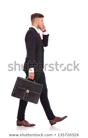 full body picture of a walking business man Stock photo © feedough