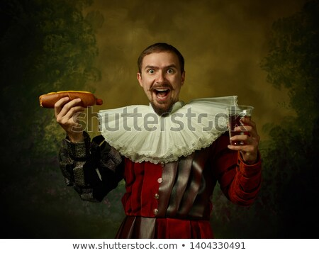 young medieval man holding a sword stock photo © dazdraperma
