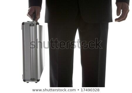 Businessman Holding Sturdy Silver Suitcase Stock photo © monkey_business