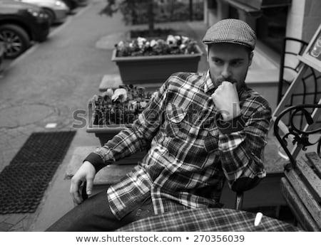 Man poseren jeans oude stad achtergrond Stockfoto © tekso