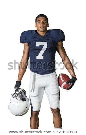 american football player posing with ball on black background stock photo © master1305
