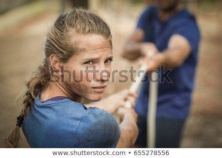 Tired woman standing in the boot camp Stock photo © wavebreak_media