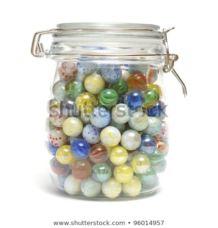 Colorful marbles in glass jar Stock photo © bluering