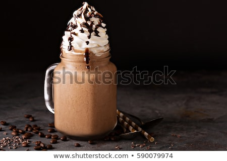 iced cocoa drink with whipped cream cold chocolate beverage coffee frappe on dark background stock photo © yelenayemchuk