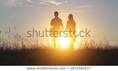 медовый · месяц · пару · наслаждаться · океана · закат · , · держась · за · руки - Сток-фото © imaster