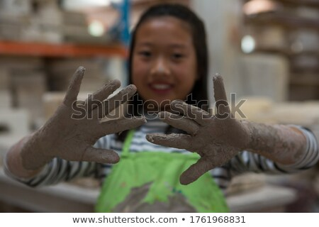 happy girl showing her muddy hand stock photo © wavebreak_media