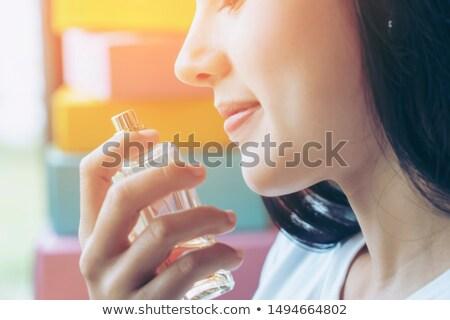 perfume · banheiro · espelho · mãos · mulheres - foto stock © is2