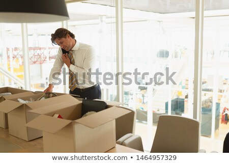 businessmen talking in front of storage Stock photo © IS2