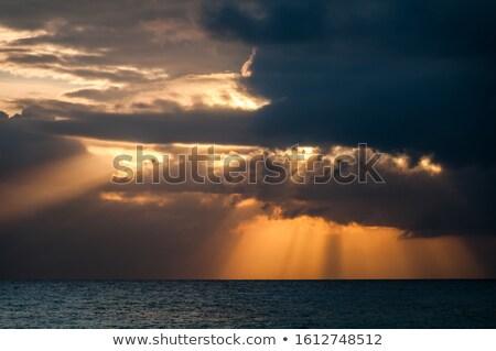 Stock fotó: Nap · sugarak · ragyogó · felhő · kék · naplemente