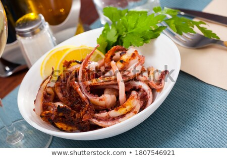 Appetizing squid on fork Stock photo © simply