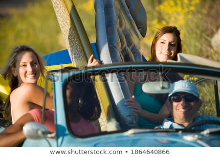 four people sitting on surfboards stock photo © is2