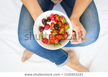 Girl holding out bowl cereal Stock photo © IS2